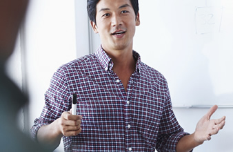 Asian man in plaid shirt